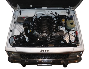 An LS engine cleanly nestled into a Cherokee Jeep